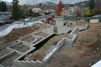 Large hillside foundation with drilled piers and retaining walls.