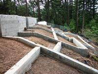 This large hillside foundation required deep drilled concrete piers and large concrete footing.  Once we completed the foundation we started the framing for this great house located in San Geronimo, which is near San Refael in Marin County.