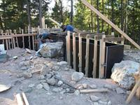 Construction of new concrete retaining walls incorporating native boulders.